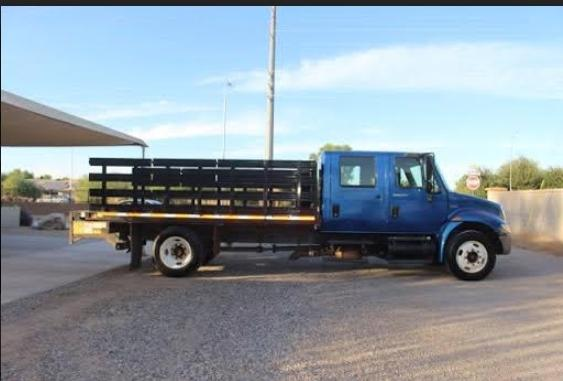 2009 International 4300 4x2 Flatbed Steak Bed photo